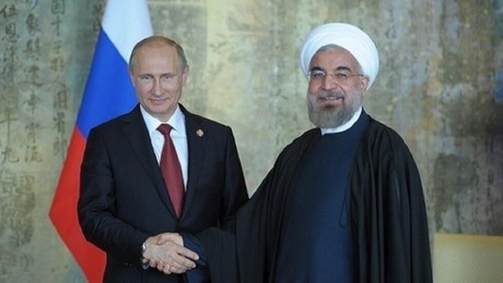 الرئيسان الروسي فلاديمير بوتين والإيراني حسن روحاني (صورة أرشيفية)