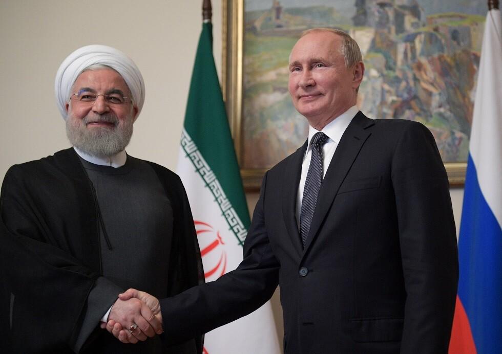 الرئيسان الروسي فلاديمير بوتين والإيراني روحاني