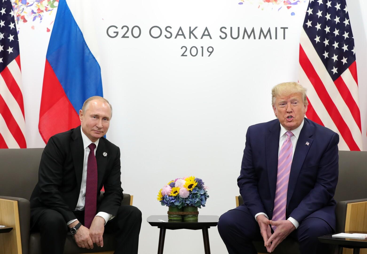 صورة من الأرشيف - الرئيسان الروسي والأمريكي في قمة العشرين باليابان