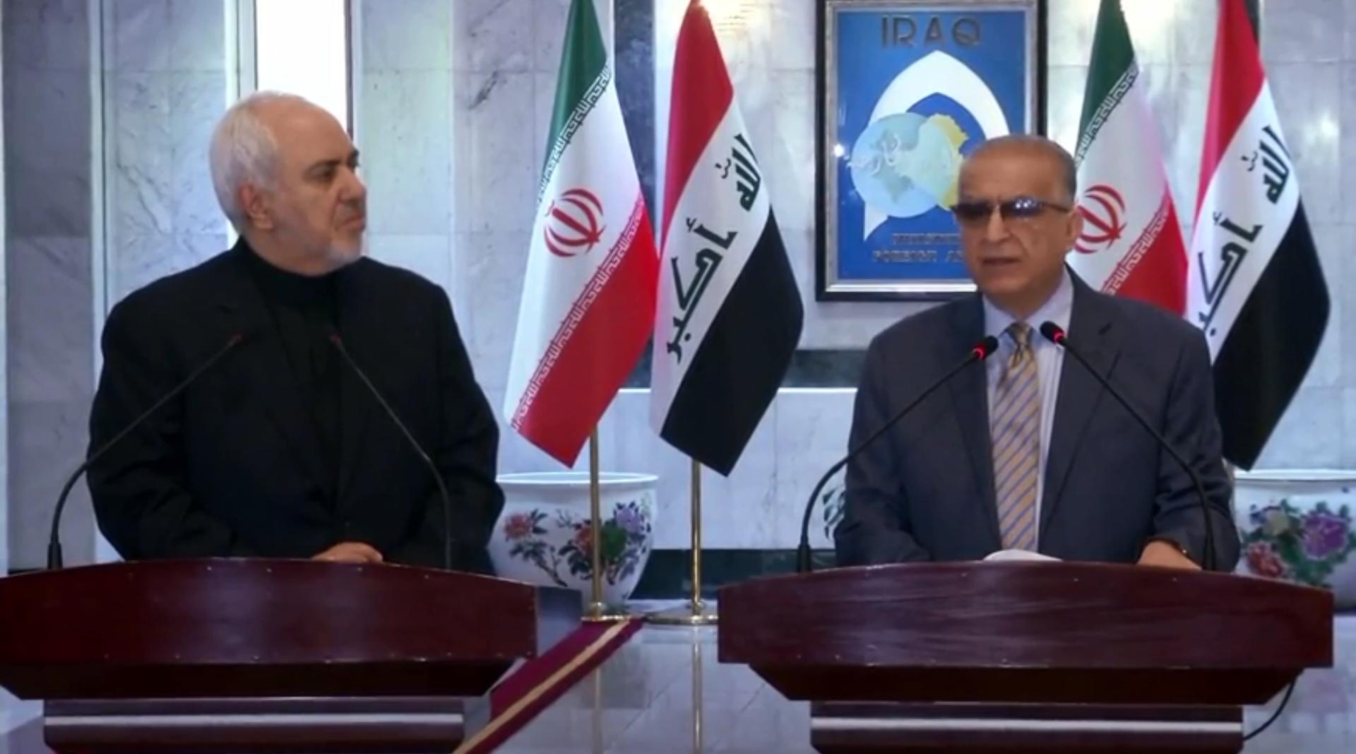وزير الخارجية العراقي، محمد علي الحكيم، ونظيره الإيراني، محمد جواد ظريف (بغداد، 26 مايو 2019).