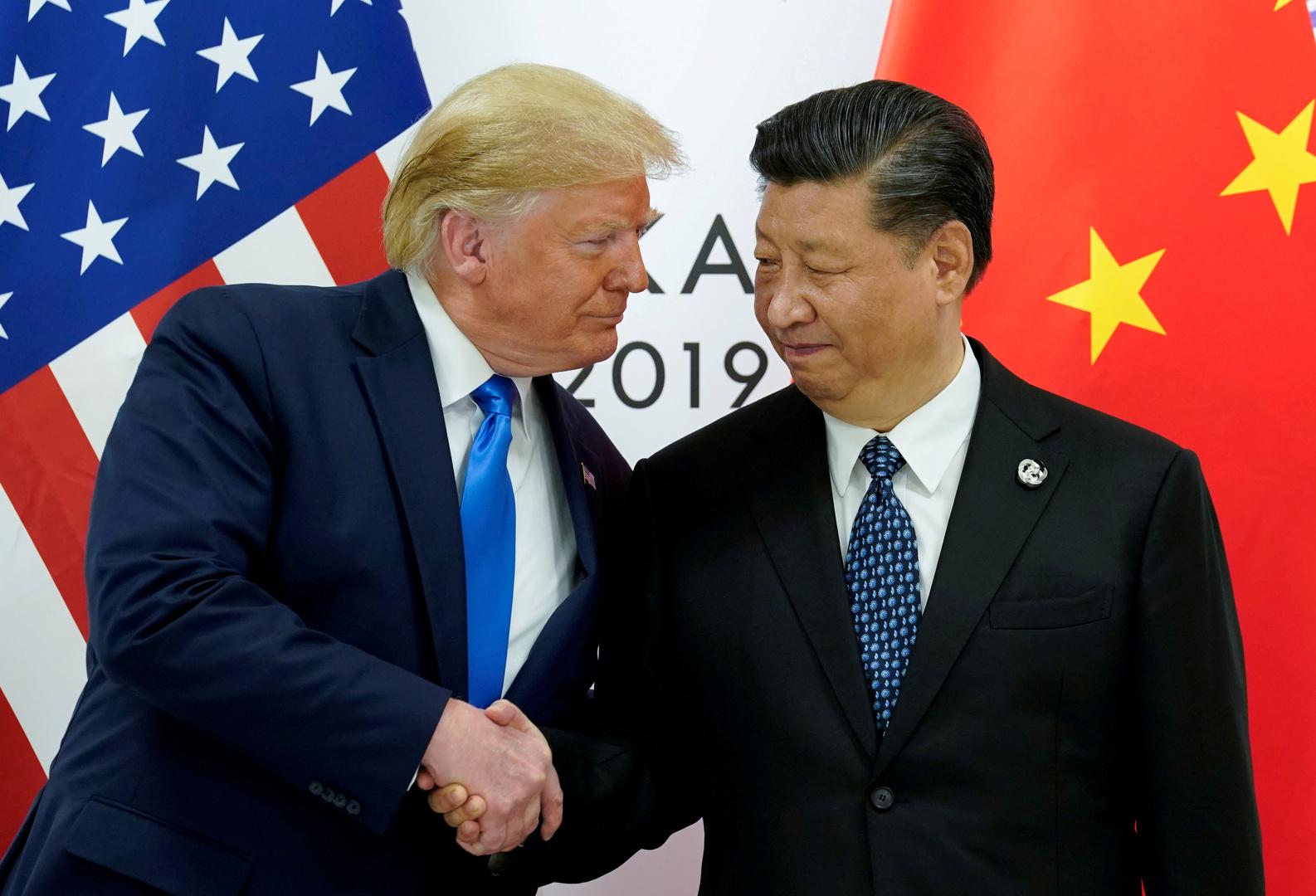 الرئيس الصيني، شي جينبينغ، ونظيره الأمريكي، دونالد ترامب، خلال لقائهما في أوساكا اليابانية يوم 20 نوفمبر 2019.