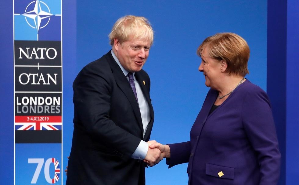 رئيس الوزراء البريطاني بوريس جونسون والمستشارة الألمانية أنغيلا ميركل