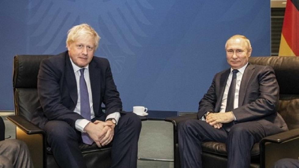 بوتين مجتمعا مع جونسون في برلين الأحد الماضي