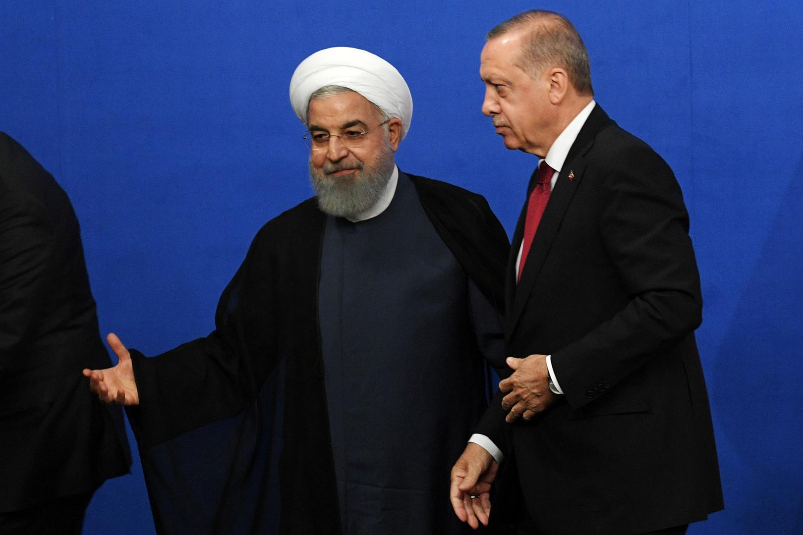 الرئيس الإيراني، حسن روحاني، ونظيره التركي، رجب طيب أردوغان