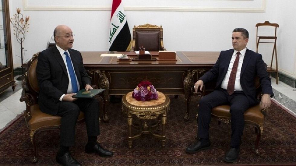 الرئيس العراقي برهم صالح مع رئيس الوزراء المكلف عدنان الزرفي