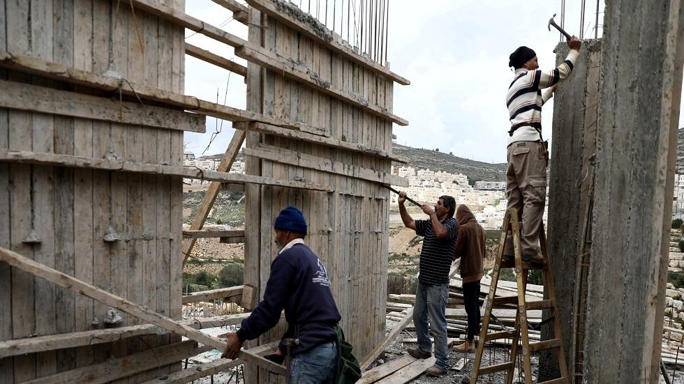 عمال فلسطينيون في إحدى المستوطنات الإسرائيلية