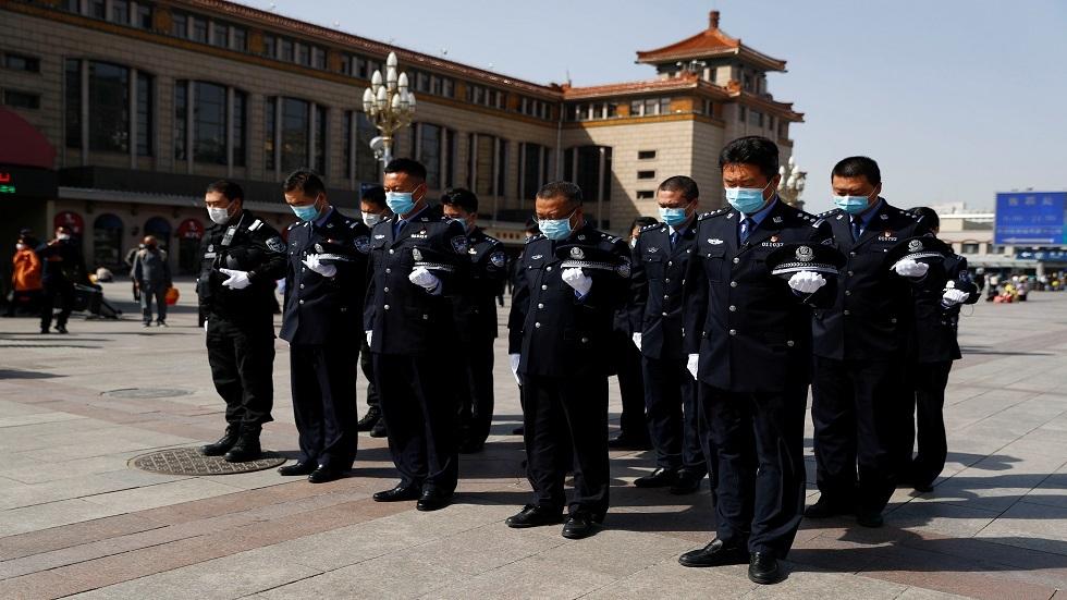 حداد عام في الصين على ضحايا كورونا (صور)