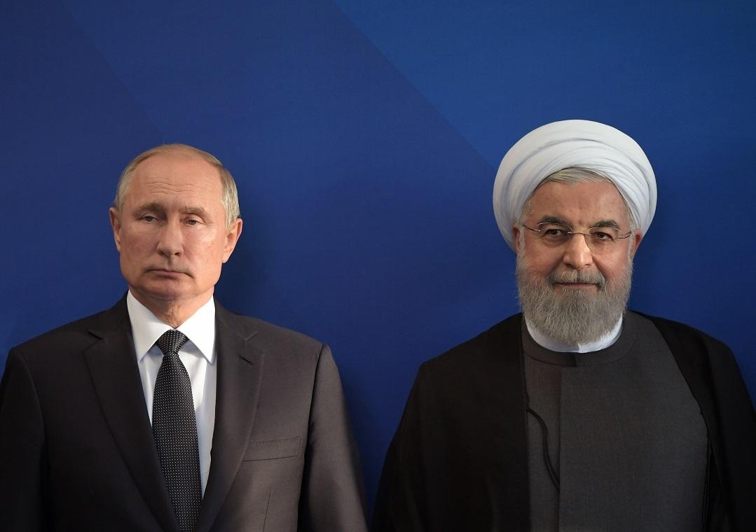 الرئيسان الروسي، فلاديمير بوتين، والإيراني، حسن روحاني