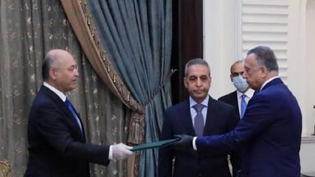 الكاظمي يتعهد بحماية سيادة العراق وحصر الأسلحة بيد الدولة