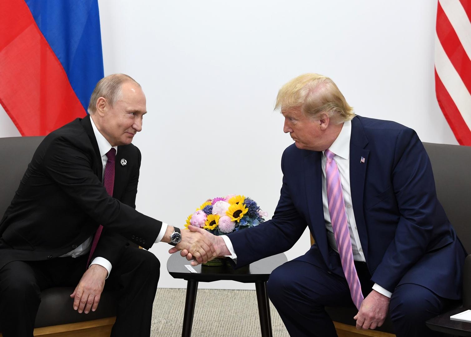 الرئيس الأمريكي، دونالد ترامب، الرئيس الروسي، فلاديمير بوتين (أوساكا، 27 يونيو 2019).