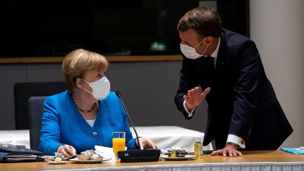 في اليوم الحاسم للقمة الأوروبية.. ماكرون وميركل يعلقان على مآلاتها المحتملة