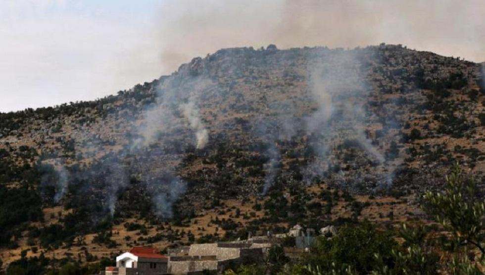 دخان يتصاعد جراء حريق نجم عن قصف المدفعية الإسرائيلية محيط بلدة كفرشوبا جنوبي لبنان