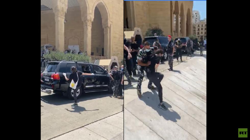 محتجون يعترضون موكب الحريري في وسط بيروت (فيديو)