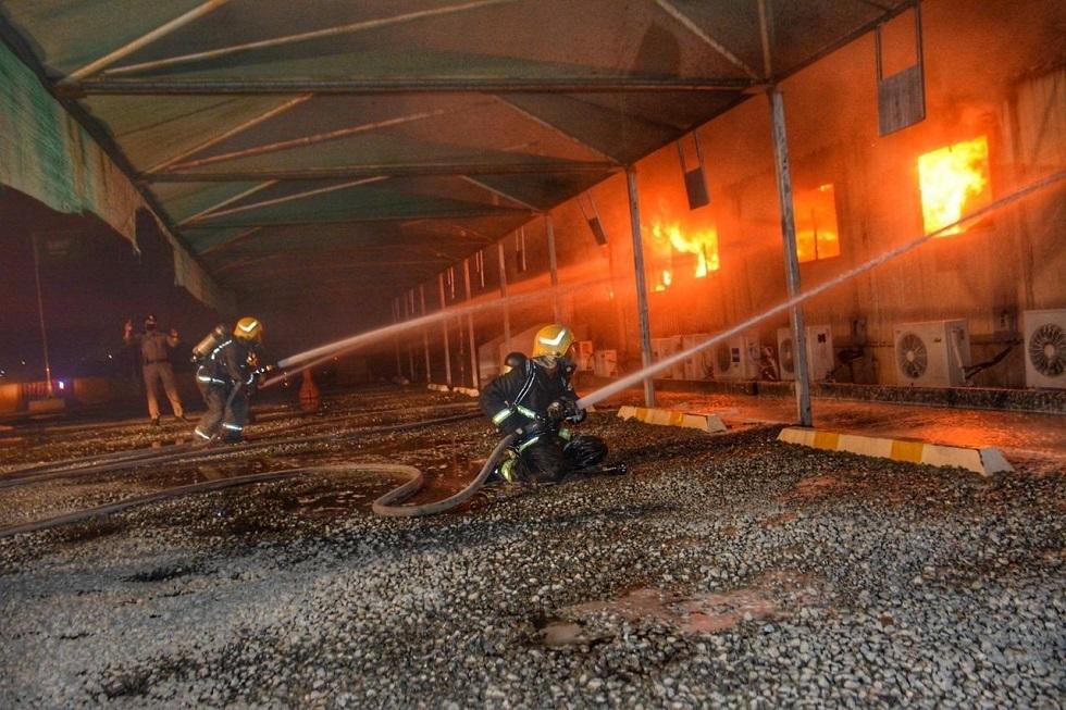 الدفاع المدني يسيطر على حريق بمحطة قطار الحرمين في السعودية صور