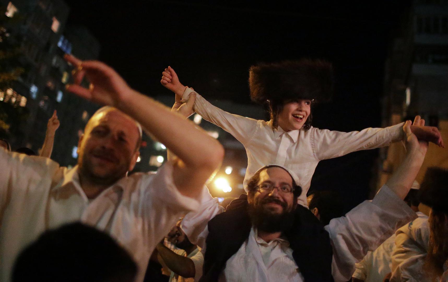 حجاج يهود يحتفلون بعيد رأس السنة اليهودية في مدينة أومان بأوكرانيا (أرشيف)