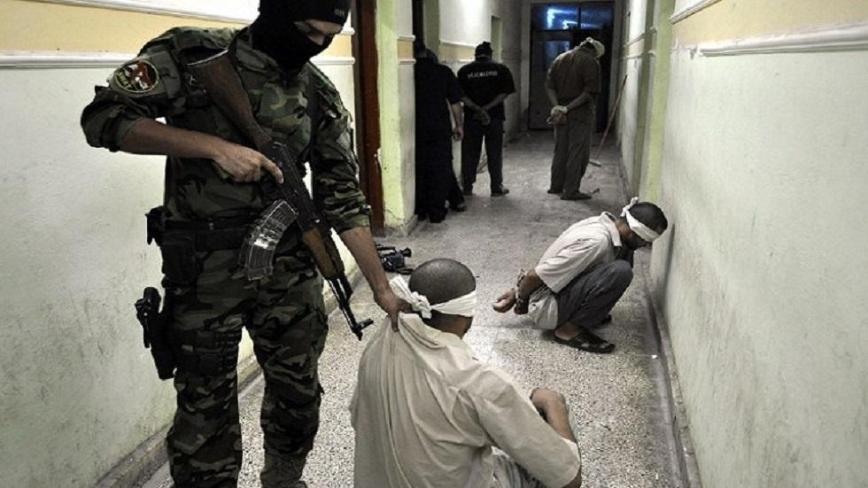 القوات العراقية تلقي القبض على مطلوبين - أرشيف