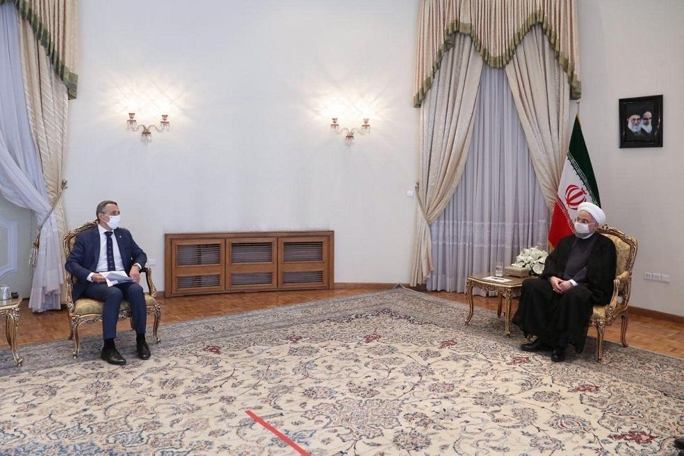 الرئيس الإيراني حسن روحاني خلال استقباله وزير خارجية سويسرا  إغناسيو كاسيس