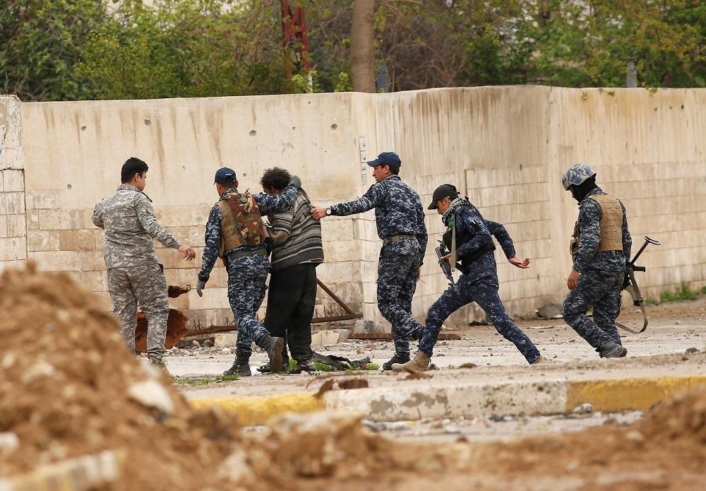 القوات العراقية تقبض على شقيقين يعملان في استخبارات