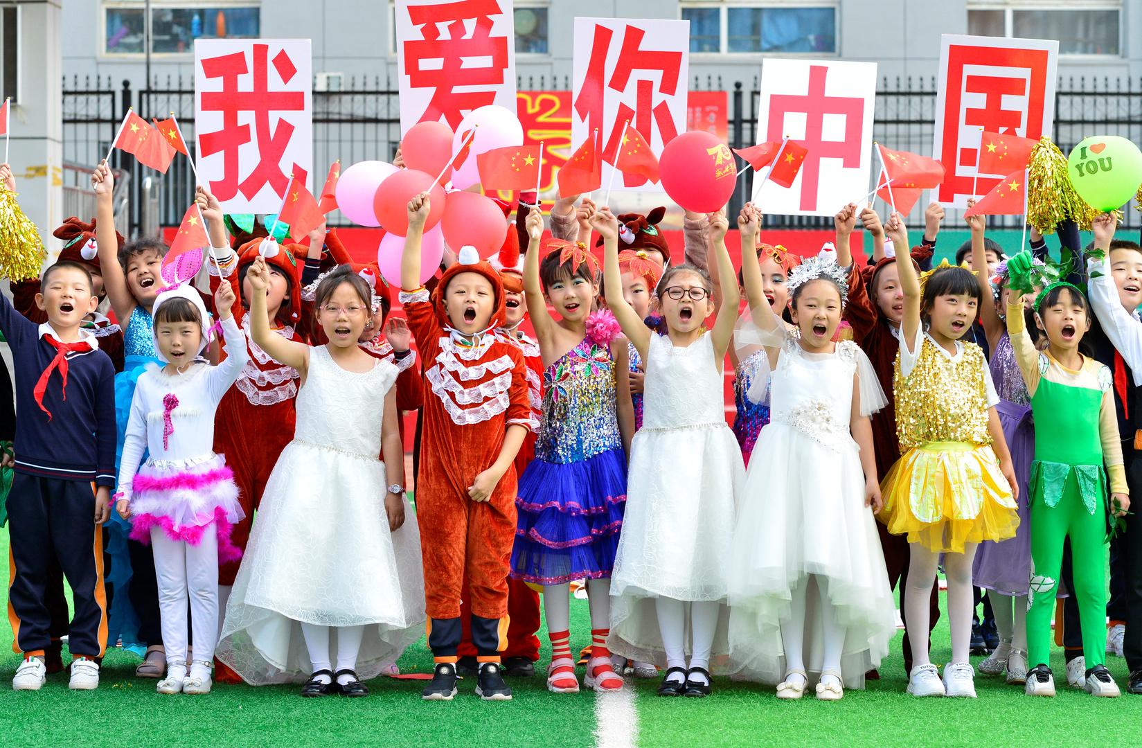 أطفال المدارس في الصين خلال أحد الأعياد. الصورة: أرشيف.