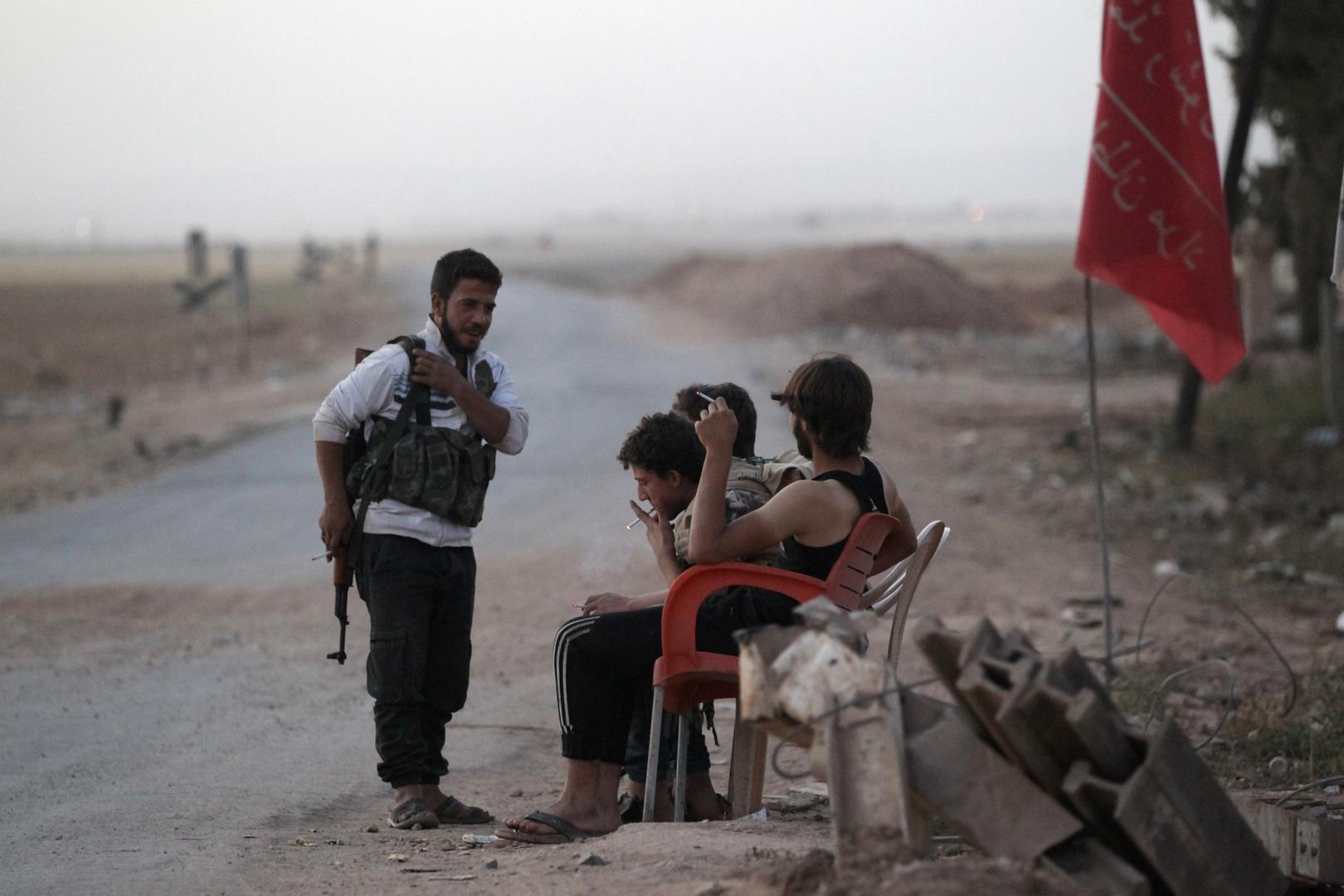 مسلحون معارضون للحكومة السورية في حلب - صورة أرشيفية
