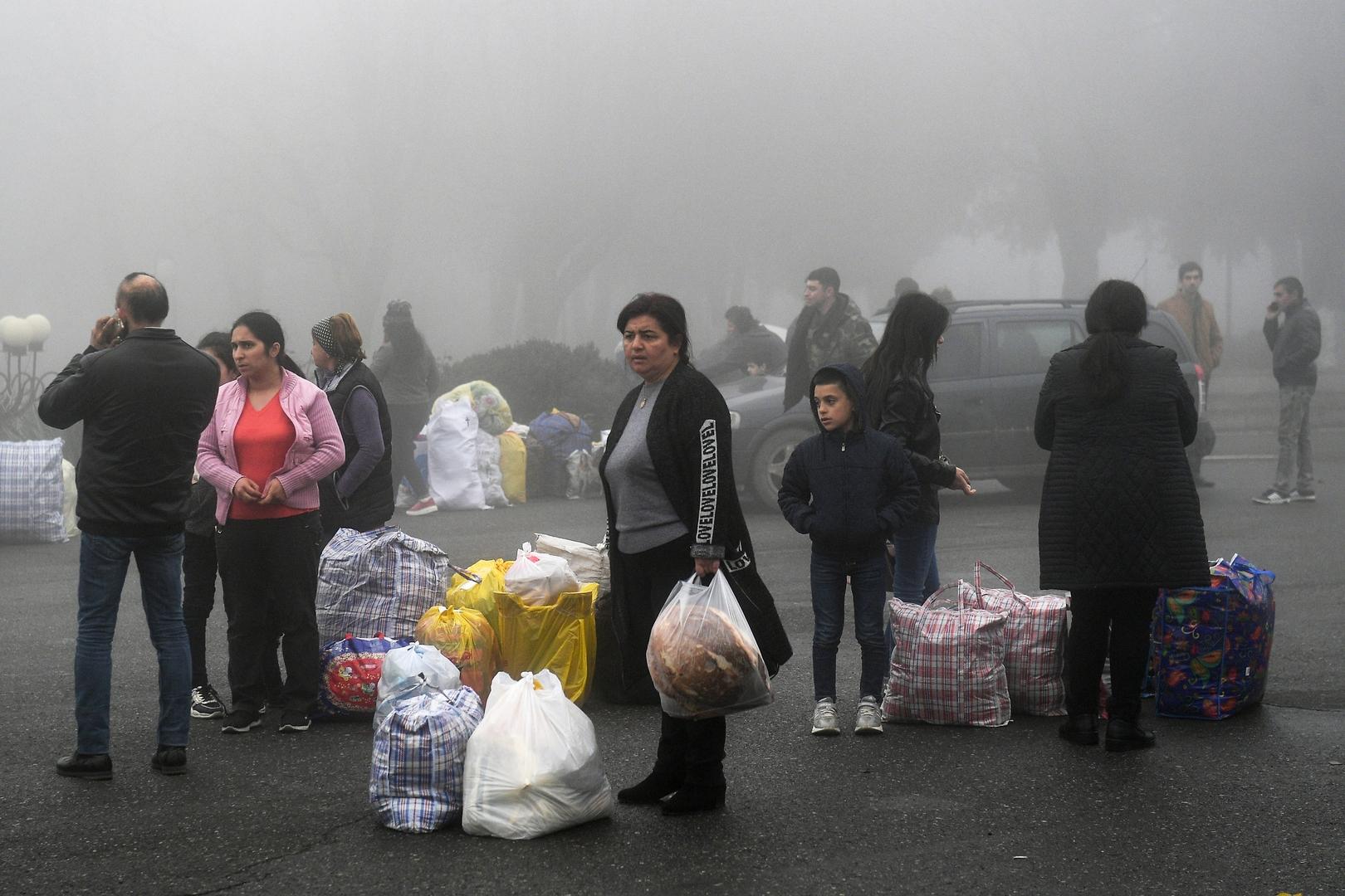 لاجئون أرمن عادوا إلى مركز إقليم قره باغ ستيباناكيرت من أرمينيا.