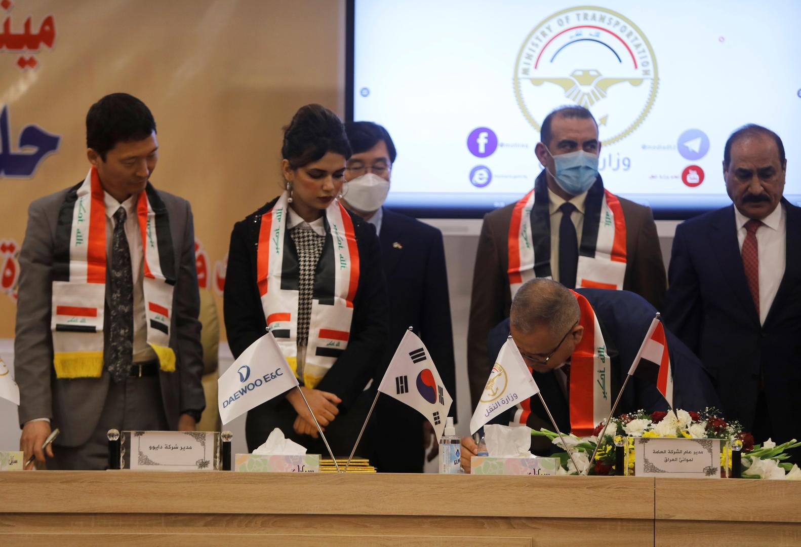 حفل توقيع الصفقة في بغداد يوم 30 ديسمبر الماضي.