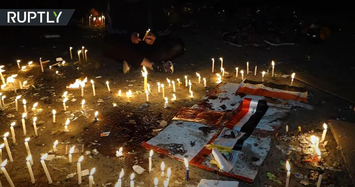سكان بغداد يوقدون الشموع حدادا على أرواح ضحايا التفجير الانتحاري المزدوج