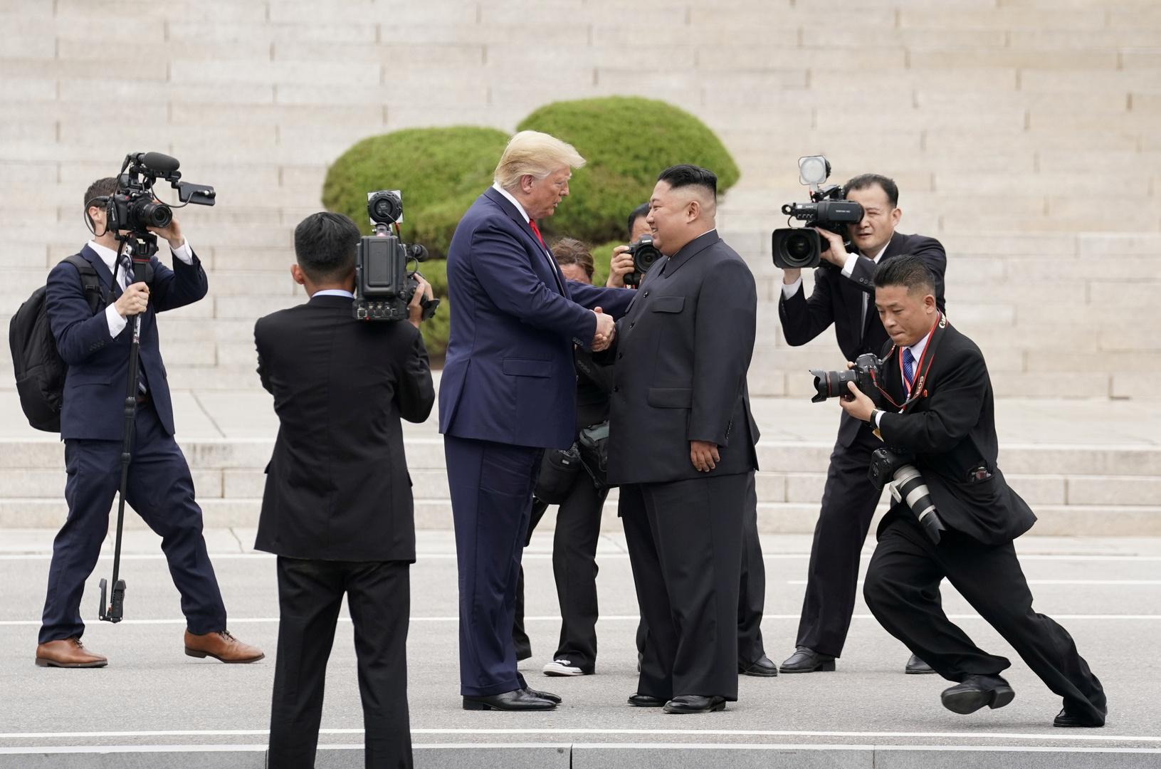 الرئيس الأمريكي السابق وزعيم كوريا الشمالية