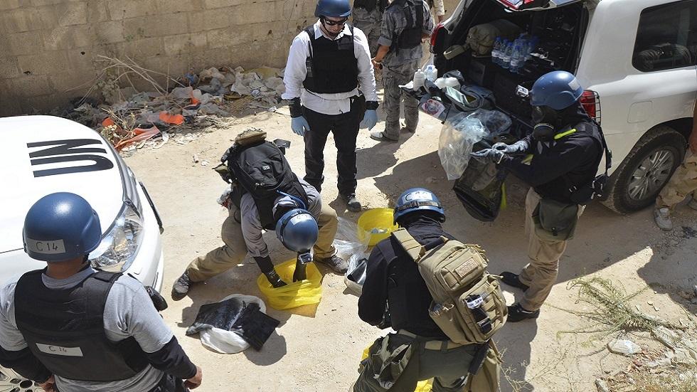 محققون أمميون في غوطة دمشق الشرقية عام 2013