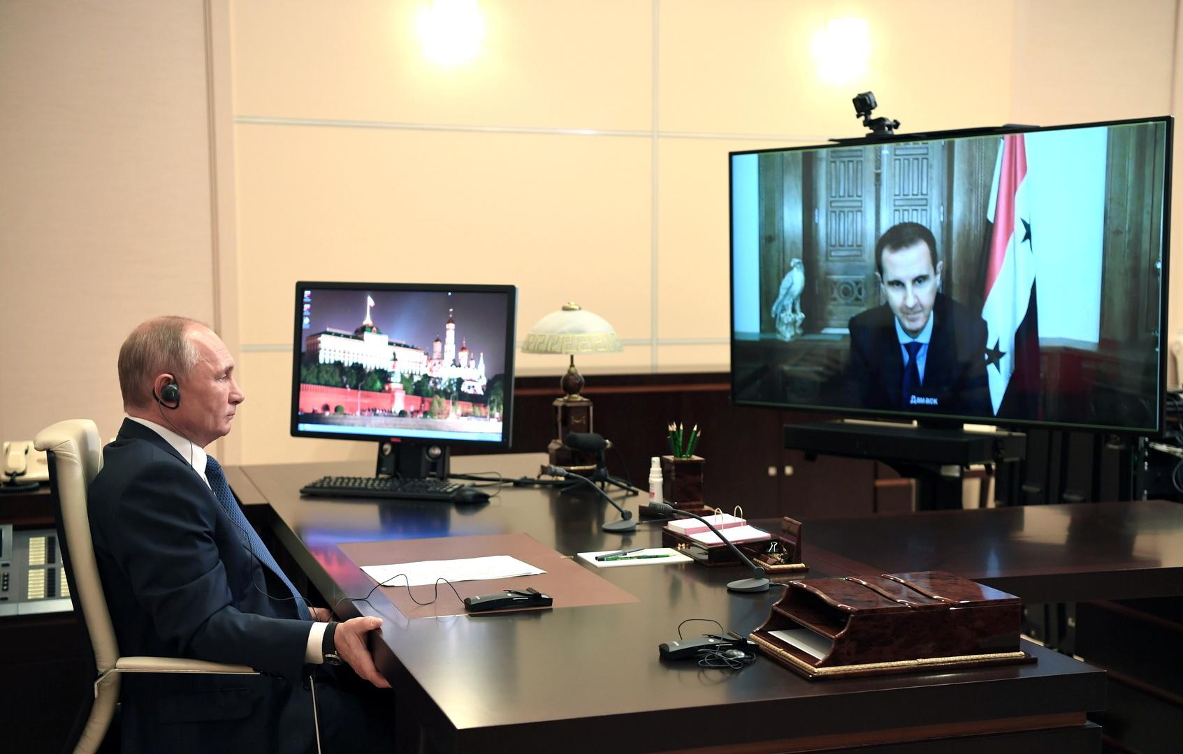 أرشيف - الرئيسان السوري والروسي