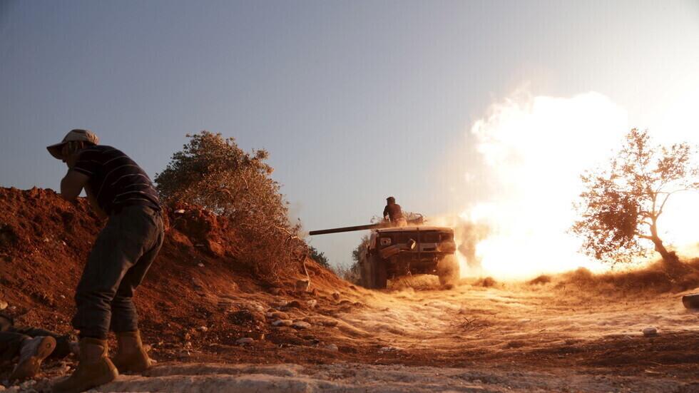 وحدات من تشكيلات مسلحة في إدلب.