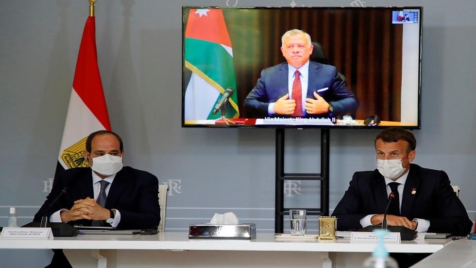 الرئيس الفرنسي إيمانويل ماكرون والرئيس المصري عبد الفتاح السيسي والملك الأردني عبد الله الثاني