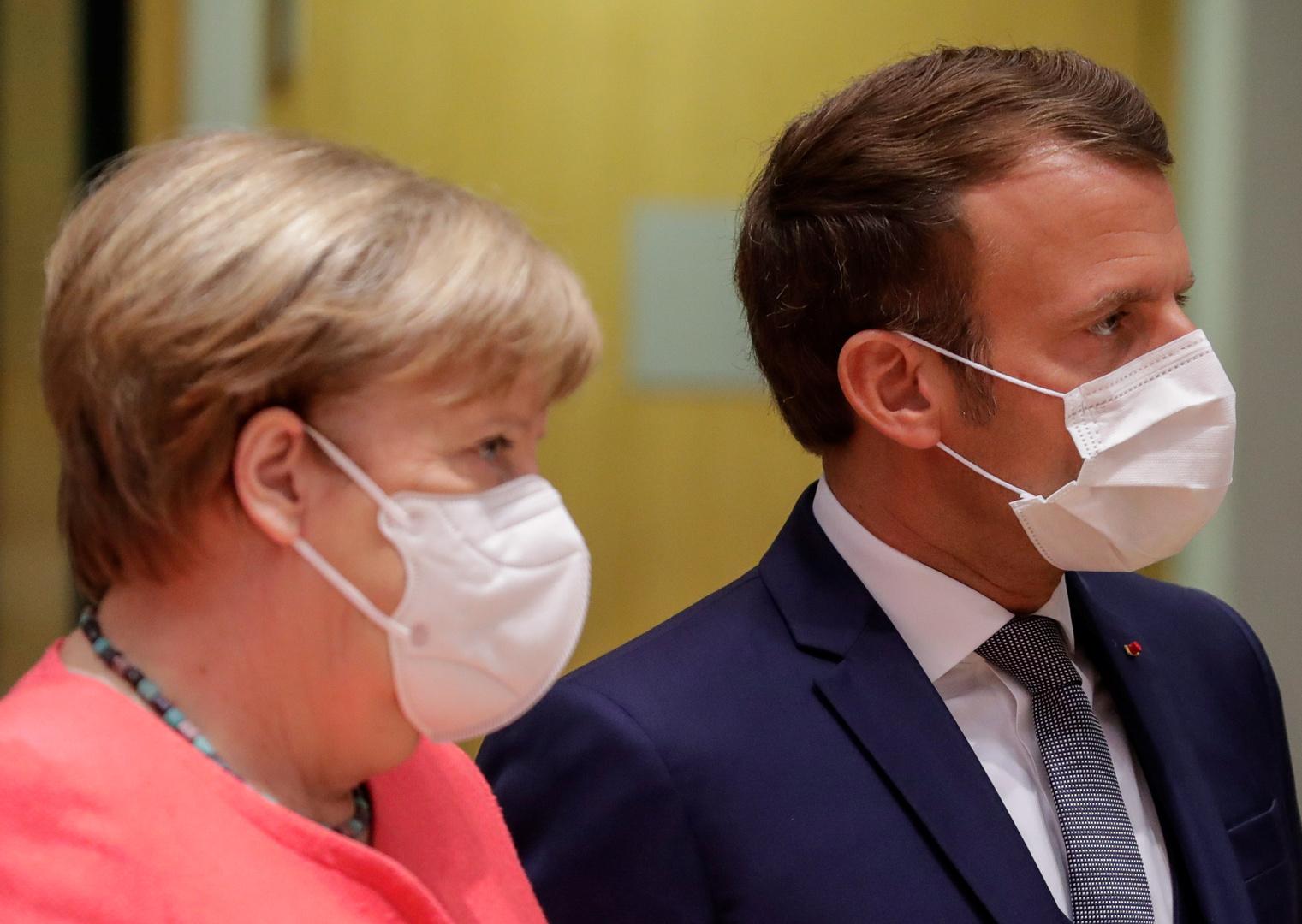 الرئيس الفرنسي إيمانويل ماكرون والمستشارة الألمانية أنغيلا ميركل (أرشيف)
