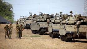 مراسلة RT: إسرائيل تحشد قوات برية كبيرة عند حدود قطاع غزة