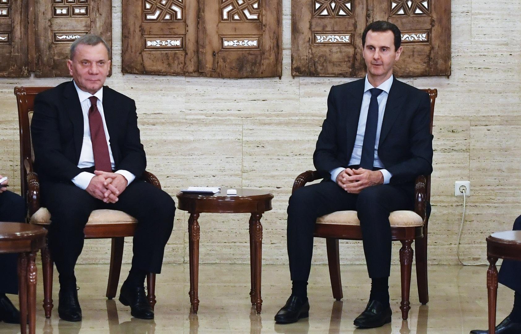 الرئيس السوري بشار الأسد ونائب رئيس الوزراء الروسي يوري بوريسوف (أرشيف)