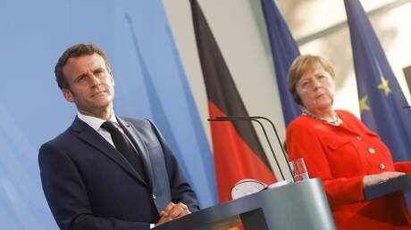 ميركل وماكرون يدعوان الاتحاد الأوروبي للحوار مع روسيا