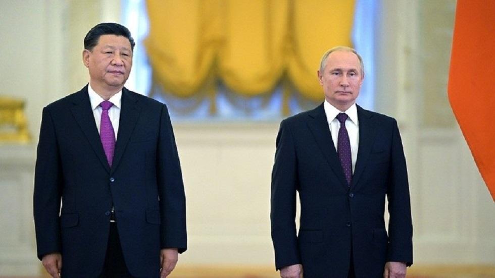 الرئيسان الروسي فلاديمير بوتين ونظيره الصيني شي جين بينغ - أرشيف