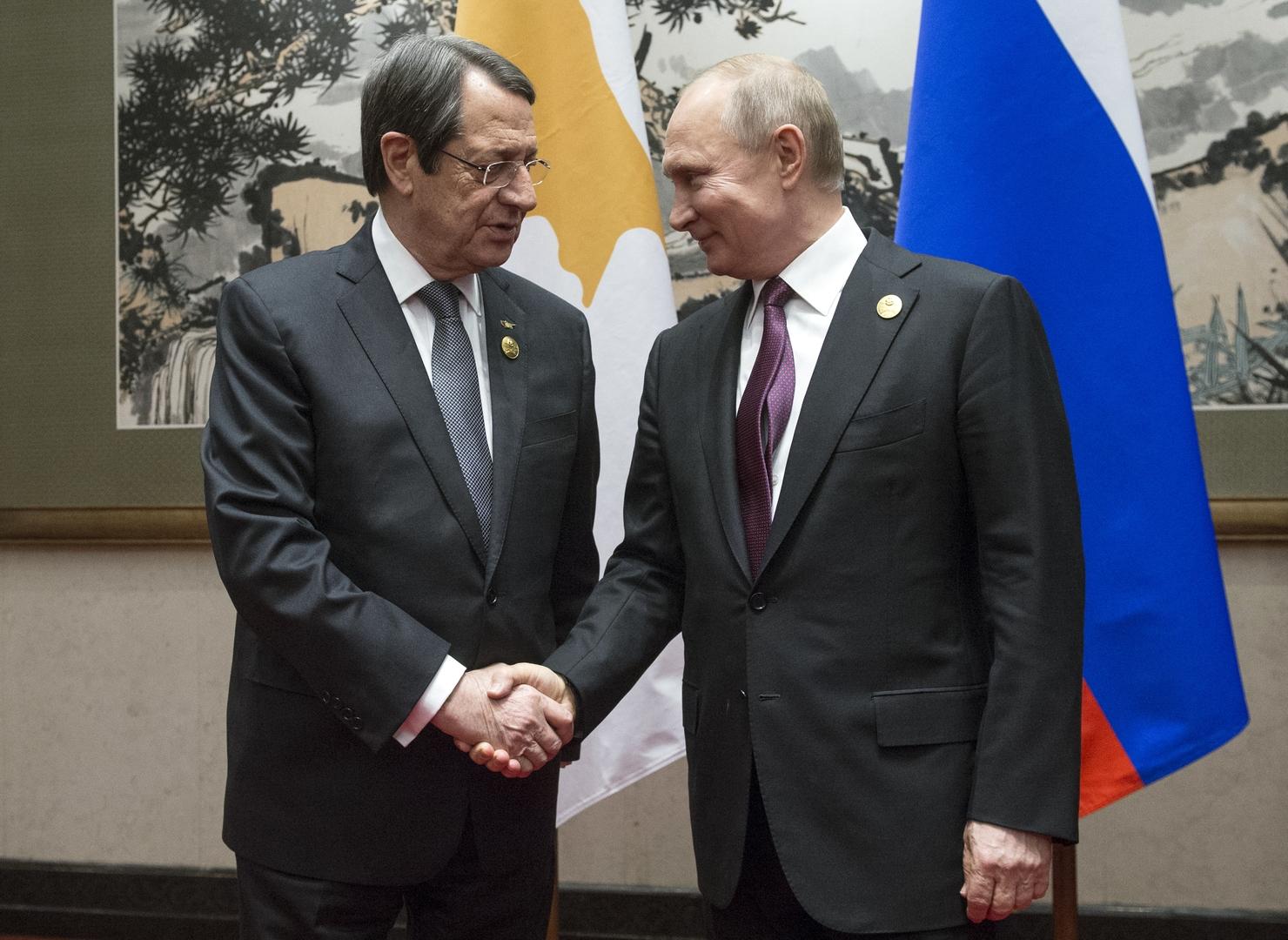 الرئيسان الروسي فلاديمير بوتين والقبرصي نيكوس أناستاسياديس (أرشيف)