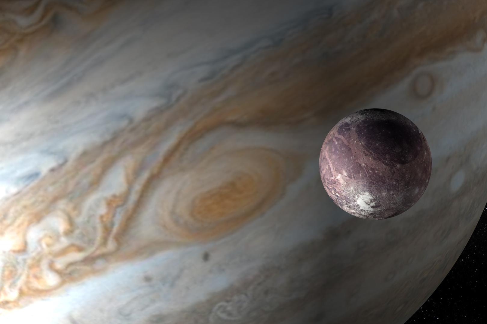 صورة تعبيرية لقمر غانيميد مقابل كوكب المشتري