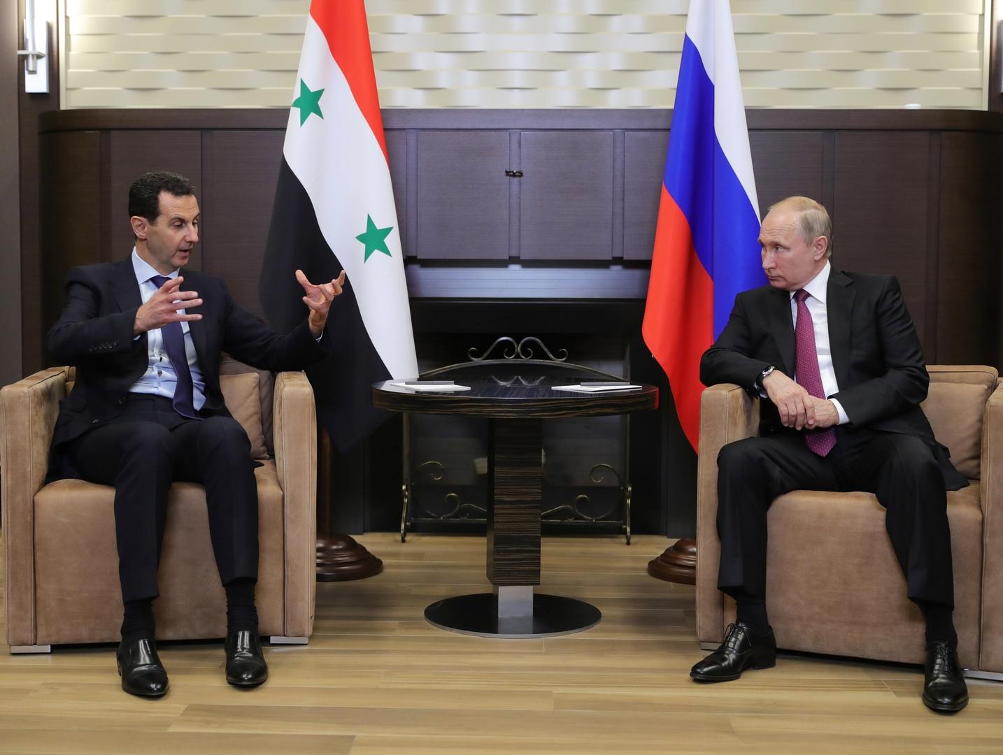 صورة من الأرشيف - الرئيسان الروسي فلاديمير بوتين والسوري بشار الأسد
