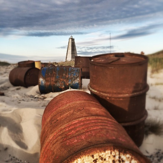 Rusty barrels in the sand