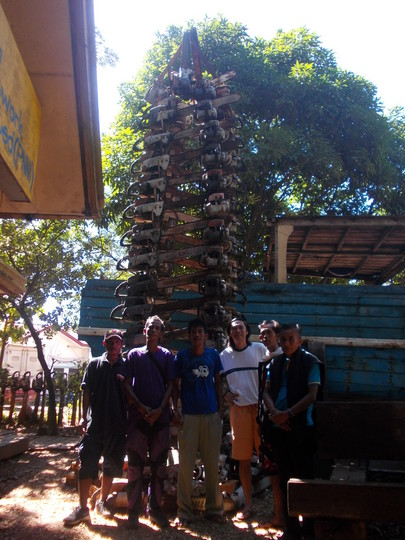 Ecological activists of Palawan Island stand in front of tower made of confiscated chainsaws