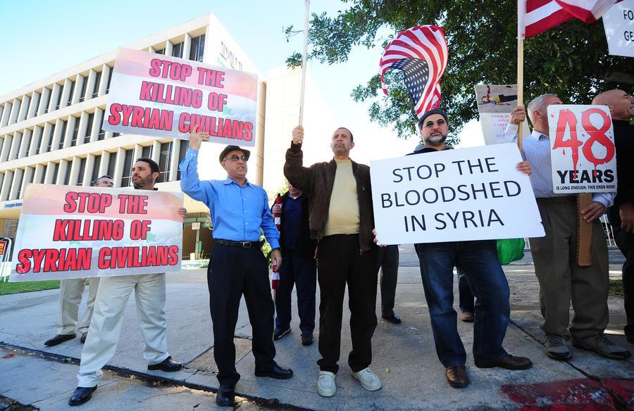 Опрос: большинство американцев против поставок оружия сирийской оппозиции