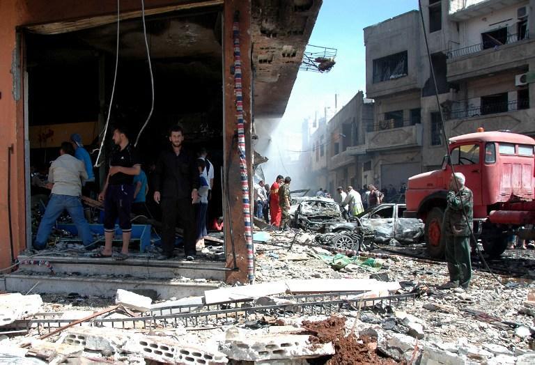 Серия терактов в Хомсе: Погибли 100 человек