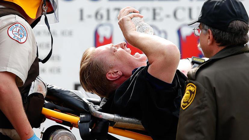 Десятки пострадавших в результате взрывов на марафоне в Бостоне  - фото с места трагедии