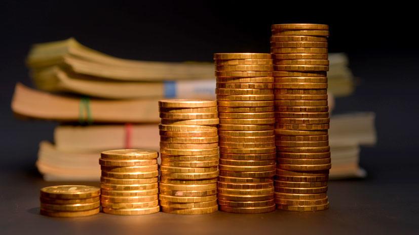 на торгах рубль укрепился к доллару США на 40 копеек