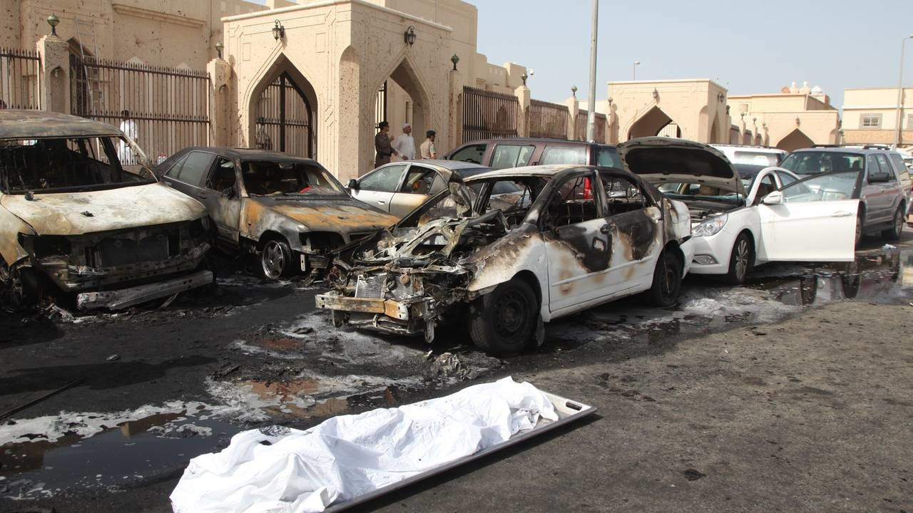 The remains of a body lie on a stretcher as Saudi security forces inspect the site of a suicide bombing that targeted the Shiite Al-Anoud mosque in the coastal city of Dammam on May 29, 2015. The Islamic State jihadist group claimed the suicide bombi