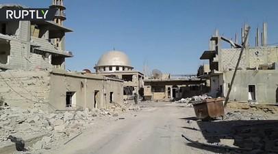 Первые кадры освобождённого сирийской армией от ИГ города Эс-Сухна
