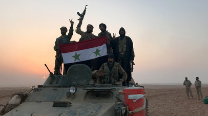 Сирийские войска близгорода Абу-Камаль