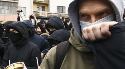 Демонстранты принимают участие в акции протеста в Минске, 15 марта 2017 года
